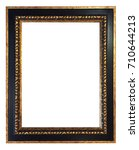 Small photo of antique black golden frame isolated on white background with cli