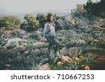 young beautiful woman hiking in ...   Shutterstock . vector #710667253