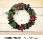 christmas wreath on the wooden... | Shutterstock . vector #710724367