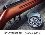 rifle gun with air pellets for... | Shutterstock . vector #710731243
