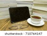 ereader next to pile of... | Shutterstock . vector #710764147