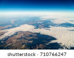 airplane view of planet earth... | Shutterstock . vector #710766247