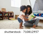 mother and baby daughter... | Shutterstock . vector #710812957