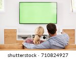 rear view of couple watching... | Shutterstock . vector #710824927