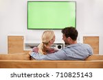 rear view of couple watching... | Shutterstock . vector #710825143