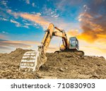 excavator in construction site | Shutterstock . vector #710830903