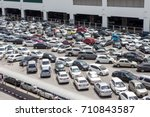 many cars in the parking lot | Shutterstock . vector #710843587