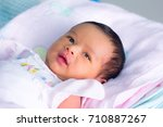 new born infant asleep in the... | Shutterstock . vector #710887267