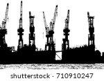 cranes in the harbor of hamburg ...   Shutterstock . vector #710910247