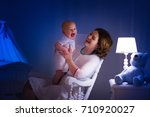 mother and baby reading a book... | Shutterstock . vector #710920027