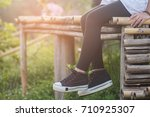 a woman sitting and relax on... | Shutterstock . vector #710925307