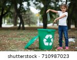 a little child putting the... | Shutterstock . vector #710987023