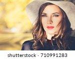sunny autumn portrait of... | Shutterstock . vector #710991283