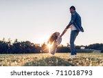 handsome man is spending time... | Shutterstock . vector #711018793