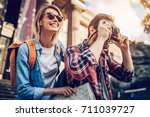 couple of tourists is exploring ... | Shutterstock . vector #711039727