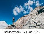 a guy is walking on a rock... | Shutterstock . vector #711056173