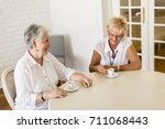 view at two older women... | Shutterstock . vector #711068443