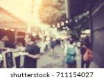 blurred night market festival... | Shutterstock . vector #711154027