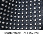 rivets in a black leather... | Shutterstock . vector #711157693