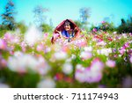 asian young woman feeling fresh ... | Shutterstock . vector #711174943