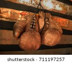 boxing gloves on the wall. old  ...   Shutterstock . vector #711197257