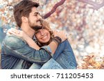 young happy couple in love... | Shutterstock . vector #711205453