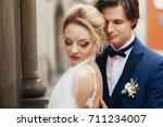 romantic bride and groom... | Shutterstock . vector #711234007