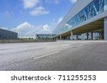 a modern factory building  | Shutterstock . vector #711255253