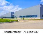 a modern factory building | Shutterstock . vector #711255937