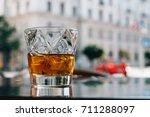 glass of whiskey on the terrace | Shutterstock . vector #711288097