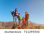 active family with three kids... | Shutterstock . vector #711295543