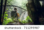 traveler with backpack see... | Shutterstock . vector #711295987