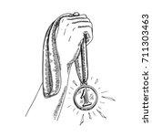holding gold medal  hand of the ...   Shutterstock .eps vector #711303463