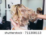 beautiful hairstyle of young... | Shutterstock . vector #711308113