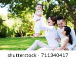 young happy asian family... | Shutterstock . vector #711340417