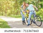 happy active family enjoying... | Shutterstock . vector #711367663