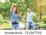 young happy woman taking a... | Shutterstock . vector #711367753