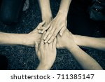 people joining hands together.... | Shutterstock . vector #711385147