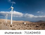 Small photo of AEOLIC PARK ,WINDMILLS, WIND FARM IN SPAIN WITH BLUE SKY AND DESERT IN FUERTEVENTURA AND MALLORCA