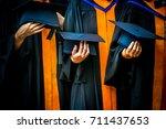 hands holding black hats ... | Shutterstock . vector #711437653