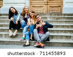 cute group of four teenagers... | Shutterstock . vector #711455893