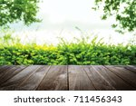 abstract natural wood table... | Shutterstock . vector #711456343