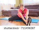 cheerful senior lady exercising ...   Shutterstock . vector #711458287