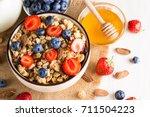healthy breakfast concept with... | Shutterstock . vector #711504223