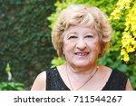 portrait of a happy elderly...   Shutterstock . vector #711544267