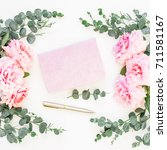 Stock photo floral frame of pink roses and eucalyptus with pink notebook and pen on white background flat lay 711581167
