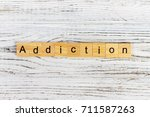 addiction word made with wooden ... | Shutterstock . vector #711587263