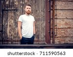 young guy with a beard and... | Shutterstock . vector #711590563