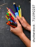 girl holding many colorful... | Shutterstock . vector #711592237