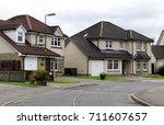 a quiet suburban cul de sac... | Shutterstock . vector #711607657